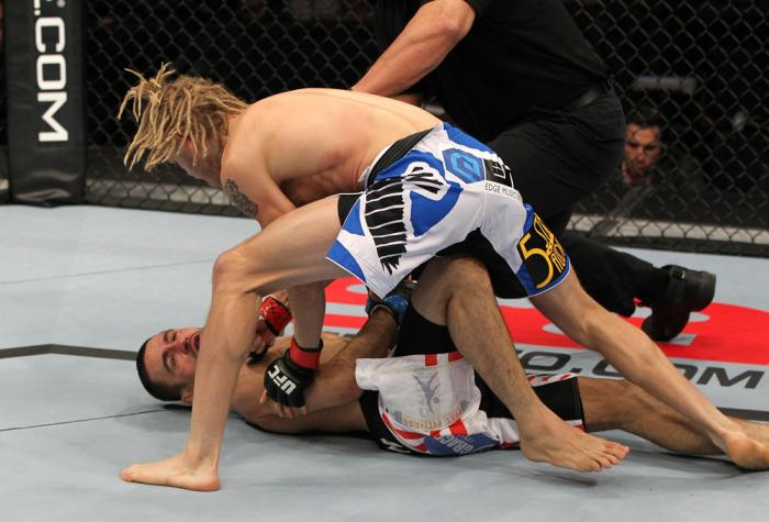 OMAHA, NE - FEBRUARY 15:  (R-L) Jonathan Brookins knocks out Vagner Rocha with a punch on the ground during the UFC on FUEL TV event at Omaha Civic Auditorium on February 15, 2012 in Omaha, Nebraska.  (Photo by Josh Hedges/Zuffa LLC/Zuffa LLC via Getty Im