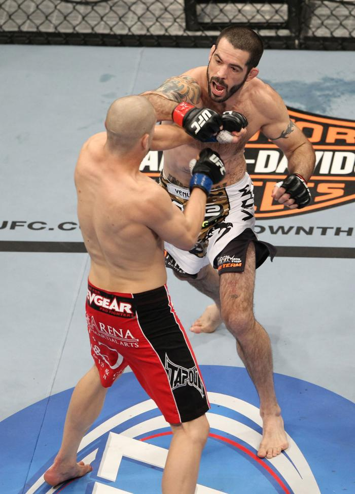 LAS VEGAS, NV - FEBRUARY 04:  Matt Brown (white shorts) and Chris Cope (red/black shorts) exchange punches during the UFC 143 event at Mandalay Bay Events Center on February 4, 2012 in Las Vegas, Nevada.  (Photo by Josh Hedges/Zuffa LLC/Zuffa LLC via Gett