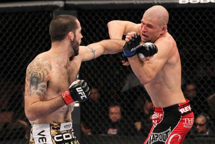 LAS VEGAS, NV - FEBRUARY 04:  Matt Brown (left) punches Chris Cope during the UFC 143 event at Mandalay Bay Events Center on February 4, 2012 in Las Vegas, Nevada.  (Photo by Nick Laham/Zuffa LLC/Zuffa LLC via Getty Images) *** Local Caption *** Matt Brow