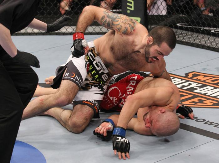 LAS VEGAS, NV - FEBRUARY 04:  Matt Brown (white shorts) attempts to finish Chris Cope during the UFC 143 event at Mandalay Bay Events Center on February 4, 2012 in Las Vegas, Nevada.  (Photo by Nick Laham/Zuffa LLC/Zuffa LLC via Getty Images) *** Local Ca