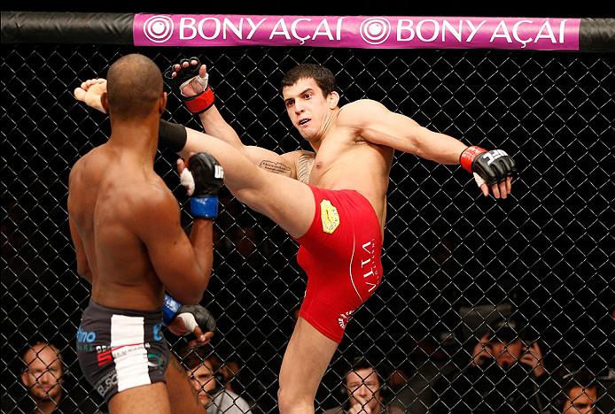 BELO HORIZONTE, BRAZIL - SEPTEMBER 04:  (R-L) Felipe Arantes kicks Kevin Souza in their featherweight fight during the UFC on FOX Sports 1 event at Mineirinho Arena on September 4, 2013 in Belo Horizonte, Brazil. (Photo by Josh Hedges/Zuffa LLC/Zuffa LLC