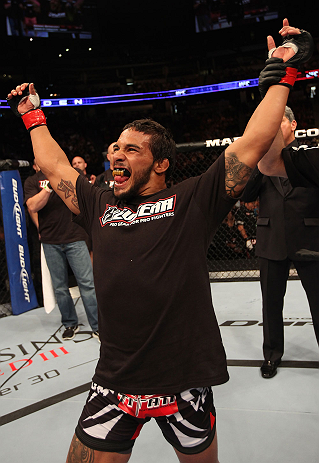 DENVER, CO - AUGUST 11:  Dennis Bermudez reacts after submitting Tom Hayden during their featherweight bout at UFC 150 inside Pepsi Center on August 11, 2012 in Denver, Colorado. (Photo by Nick Laham/Zuffa LLC/Zuffa LLC via Getty Images)