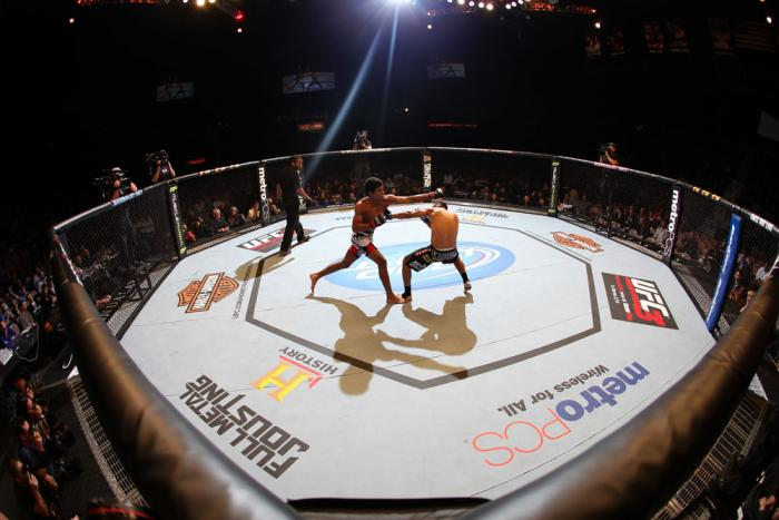 LAS VEGAS, NV - FEBRUARY 04:  (L-R) Alex Caceres and Edwin Figueroa exchange blows during the UFC 143 event at Mandalay Bay Events Center on February 4, 2012 in Las Vegas, Nevada.  (Photo by Nick Laham/Zuffa LLC/Zuffa LLC via Getty Images) *** Local Capti