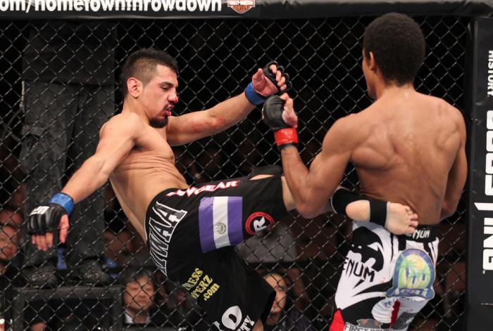 LAS VEGAS, NV - FEBRUARY 04:  Edwin Figueroa (left) kicks Alex Caceres during the UFC 143 event at Mandalay Bay Events Center on February 4, 2012 in Las Vegas, Nevada.  (Photo by Nick Laham/Zuffa LLC/Zuffa LLC via Getty Images) *** Local Caption *** Edwin