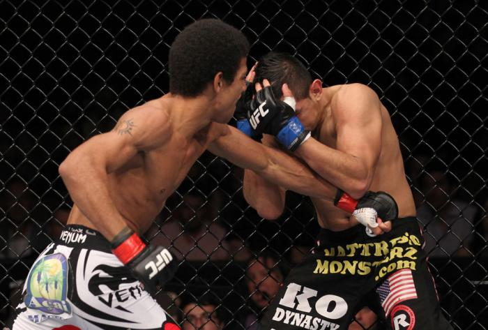 LAS VEGAS, NV - FEBRUARY 04:  Alex Caceres (left) punches Edwin Figueroa during the UFC 143 event at Mandalay Bay Events Center on February 4, 2012 in Las Vegas, Nevada.  (Photo by Nick Laham/Zuffa LLC/Zuffa LLC via Getty Images) *** Local Caption *** Ale