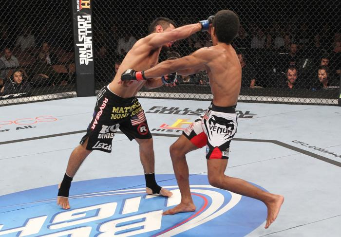 LAS VEGAS, NV - FEBRUARY 04:  Edwin Figueroa (left) punches Alex Caceres during the UFC 143 event at Mandalay Bay Events Center on February 4, 2012 in Las Vegas, Nevada.  (Photo by Nick Laham/Zuffa LLC/Zuffa LLC via Getty Images) *** Local Caption *** Edw
