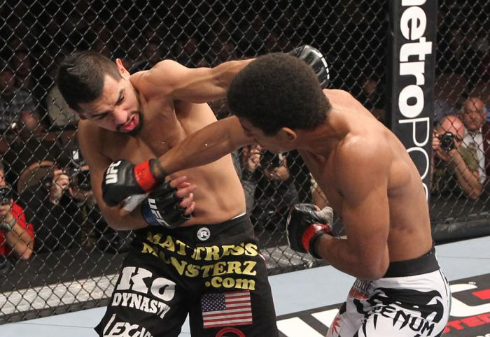 LAS VEGAS, NV - FEBRUARY 04:  (L-R) Edwin Figueroa and Alex Caceres during the UFC 143 event at Mandalay Bay Events Center on February 4, 2012 in Las Vegas, Nevada.  (Photo by Nick Laham/Zuffa LLC/Zuffa LLC via Getty Images) *** Local Caption *** Edwin Fi