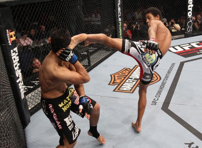 LAS VEGAS, NV - FEBRUARY 04:  Alex Caceres (right) kicks Edwin Figueroa during the UFC 143 event at Mandalay Bay Events Center on February 4, 2012 in Las Vegas, Nevada.  (Photo by Nick Laham/Zuffa LLC/Zuffa LLC via Getty Images) *** Local Caption *** Alex