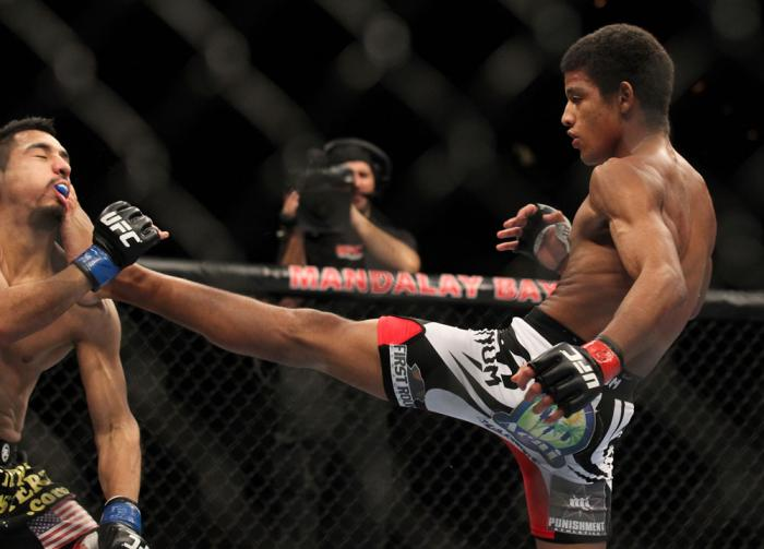 LAS VEGAS, NV - FEBRUARY 04:  Alex Caceres (right) kicks Edwin Figueroa during the UFC 143 event at Mandalay Bay Events Center on February 4, 2012 in Las Vegas, Nevada.  (Photo by Josh Hedges/Zuffa LLC/Zuffa LLC via Getty Images) *** Local Caption *** Ale