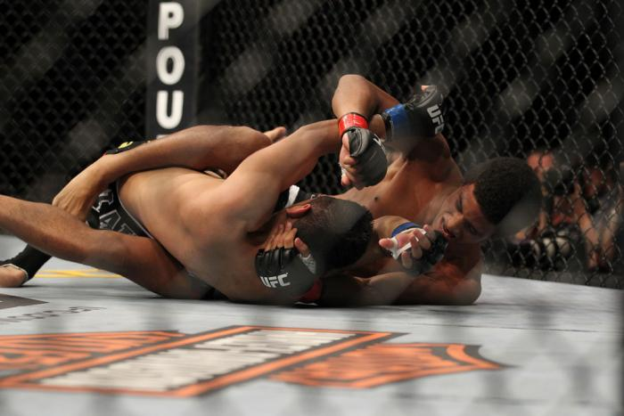 LAS VEGAS, NV - FEBRUARY 04:  Alex Caceres (right) throws punches at Edwin Figueroa on the ground during the UFC 143 event at Mandalay Bay Events Center on February 4, 2012 in Las Vegas, Nevada.  (Photo by Josh Hedges/Zuffa LLC/Zuffa LLC via Getty Images)