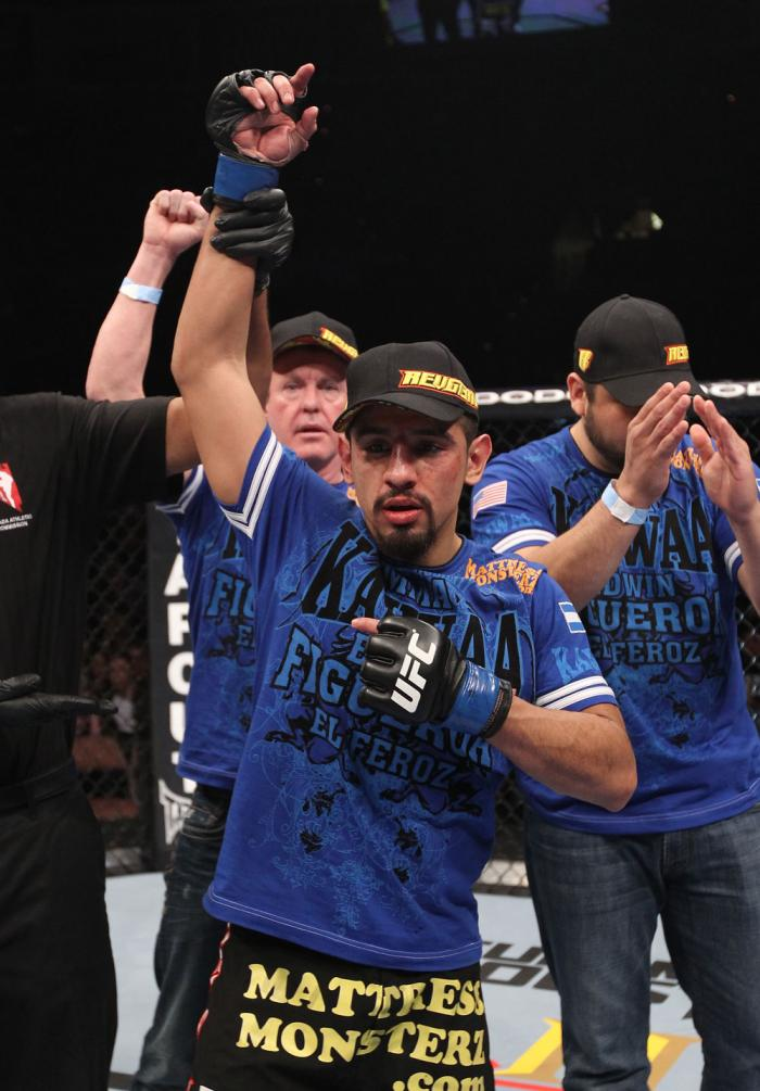 LAS VEGAS, NV - FEBRUARY 04:  Edwin Figueroa is declared the winner in his fight against Alex Caceres during the UFC 143 event at Mandalay Bay Events Center on February 4, 2012 in Las Vegas, Nevada.  (Photo by Nick Laham/Zuffa LLC/Zuffa LLC via Getty Imag