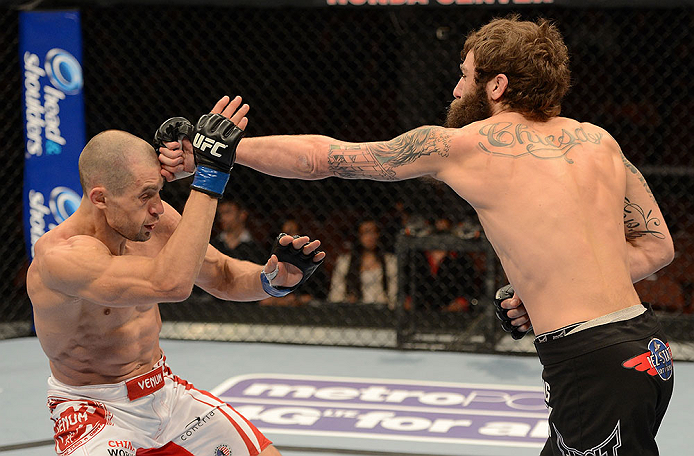 ANAHEIM, CA - FEBRUARY 23:  (R-L) Michael Chiesa punches Anton Kuivanen in their lightweight bout during UFC 157 at Honda Center on February 23, 2013 in Anaheim, California.  (Photo by Donald Miralle/Zuffa LLC/Zuffa LLC via Getty Images) *** Local Caption