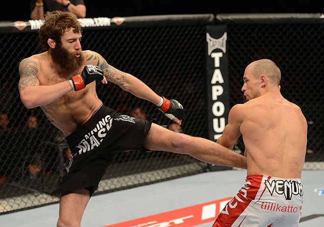 ANAHEIM, CA - FEBRUARY 23:  (L-R) Michael Chiesa kicks Anton Kuivanen in their lightweight bout during UFC 157 at Honda Center on February 23, 2013 in Anaheim, California.  (Photo by Donald Miralle/Zuffa LLC/Zuffa LLC via Getty Images) *** Local Caption *