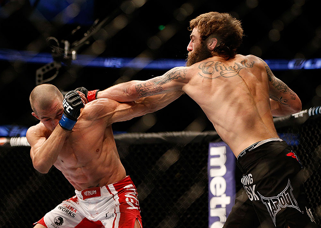 ANAHEIM, CA - FEBRUARY 23:  (R-L) Michael Chiesa punches Anton Kuivanen in their lightweight bout during UFC 157 at Honda Center on February 23, 2013 in Anaheim, California.  (Photo by Josh Hedges/Zuffa LLC/Zuffa LLC via Getty Images) *** Local Caption **