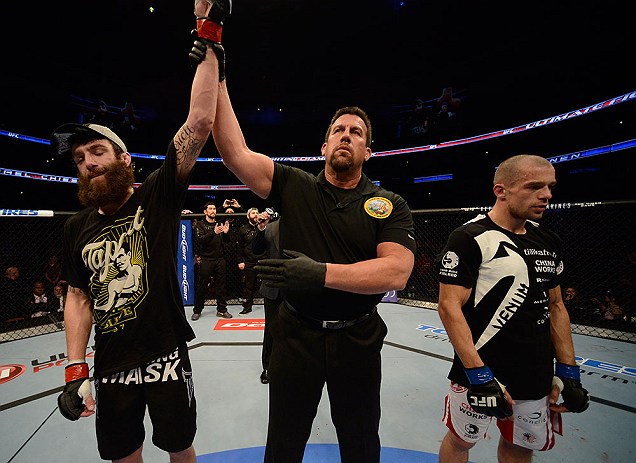 ANAHEIM, CA - FEBRUARY 23:  Michael Chiesa (left) is named the winner over Anton Kuivanen (right) after their lightweight bout during UFC 157 at Honda Center on February 23, 2013 in Anaheim, California.  (Photo by Donald Miralle/Zuffa LLC/Zuffa LLC via Ge