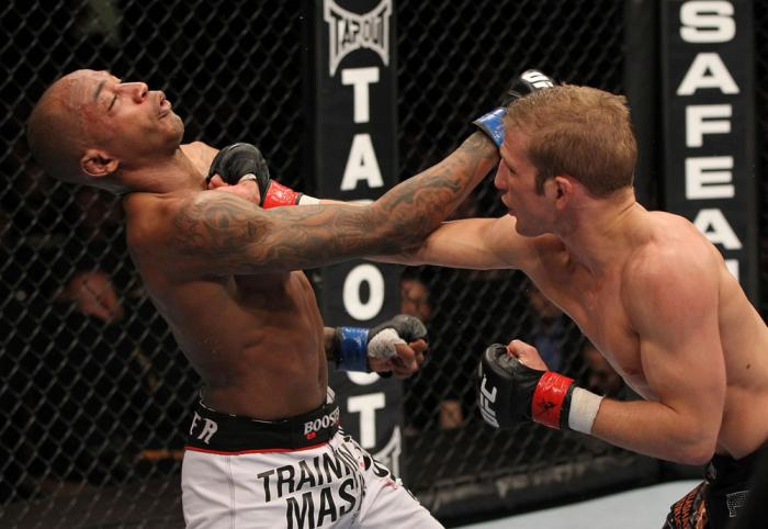 OMAHA, NE - FEBRUARY 15:  (R-L) TJ Dillashaw punches Walel Watson during the UFC on FUEL TV event at Omaha Civic Auditorium on February 15, 2012 in Omaha, Nebraska.  (Photo by Josh Hedges/Zuffa LLC/Zuffa LLC via Getty Images) *** Local Caption *** TJ Dill