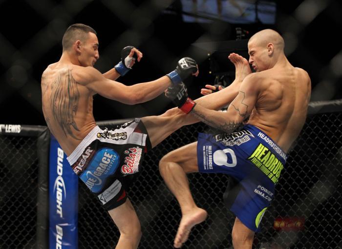 LAS VEGAS, NV - FEBRUARY 04:  Max Holloway (left) kicks Dustin Poirier during the UFC 143 event at Mandalay Bay Events Center on February 4, 2012 in Las Vegas, Nevada.  (Photo by Josh Hedges/Zuffa LLC/Zuffa LLC via Getty Images) *** Local Caption *** Max