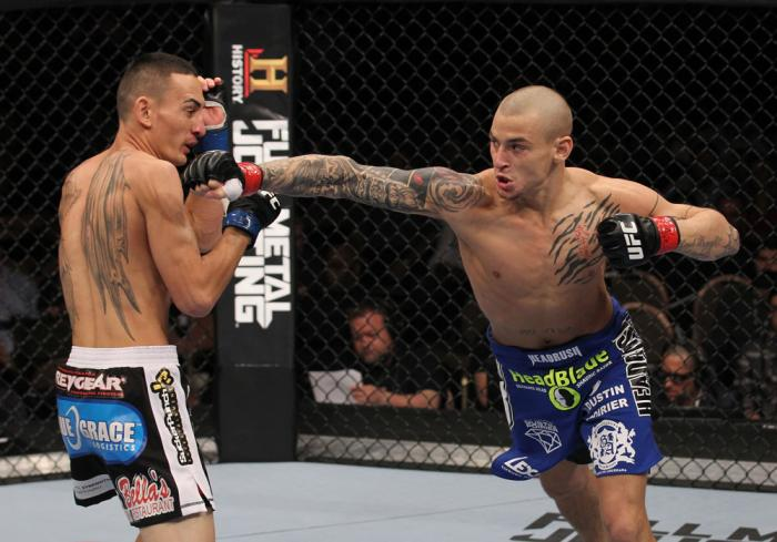 LAS VEGAS, NV - FEBRUARY 04:  Dustin Poirier (right) punches Max Holloway during the UFC 143 event at Mandalay Bay Events Center on February 4, 2012 in Las Vegas, Nevada.  (Photo by Nick Laham/Zuffa LLC/Zuffa LLC via Getty Images) *** Local Caption *** Du