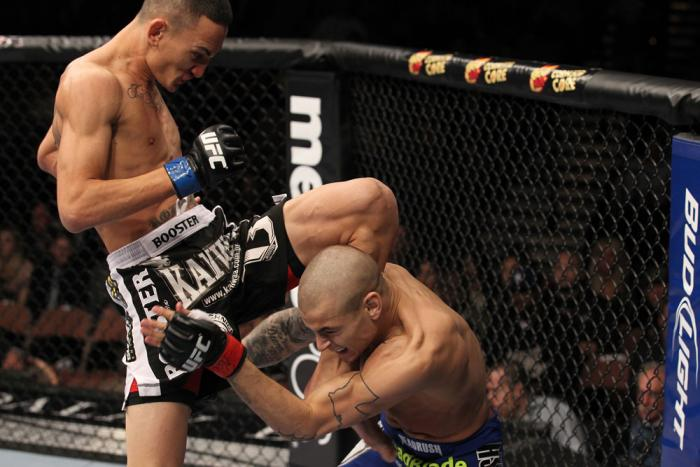 LAS VEGAS, NV - FEBRUARY 04:  Max Holloway (black shorts) delivers a knee to Dustin Poirier during the UFC 143 event at Mandalay Bay Events Center on February 4, 2012 in Las Vegas, Nevada.  (Photo by Nick Laham/Zuffa LLC/Zuffa LLC via Getty Images) *** Lo