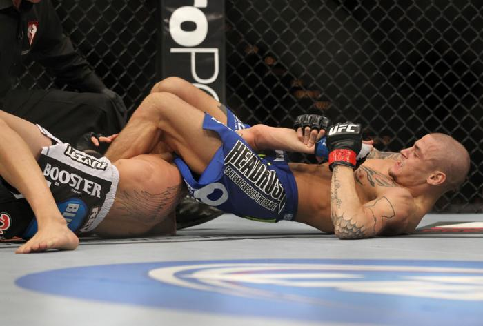 LAS VEGAS, NV - FEBRUARY 04:  Dustin Poirier (blue shorts) attempts to submit Max Holloway during the UFC 143 event at Mandalay Bay Events Center on February 4, 2012 in Las Vegas, Nevada.  (Photo by Josh Hedges/Zuffa LLC/Zuffa LLC via Getty Images) *** Lo