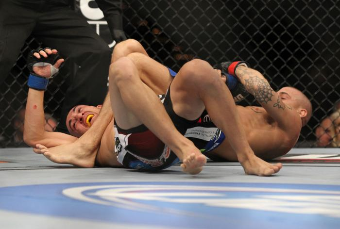 LAS VEGAS, NV - FEBRUARY 04:  Dustin Poirier (right) attempts to submit Max Holloway during the UFC 143 event at Mandalay Bay Events Center on February 4, 2012 in Las Vegas, Nevada.  (Photo by Josh Hedges/Zuffa LLC/Zuffa LLC via Getty Images) *** Local Ca