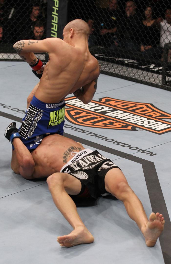 LAS VEGAS, NV - FEBRUARY 04:  Dustin Poirier (blue shorts) attempts to submit Max Holloway during the UFC 143 event at Mandalay Bay Events Center on February 4, 2012 in Las Vegas, Nevada.  (Photo by Nick Laham/Zuffa LLC/Zuffa LLC via Getty Images) *** Loc