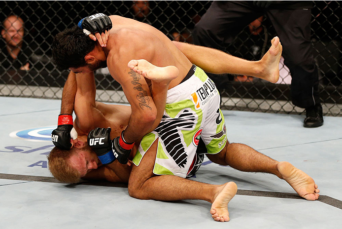 BELO HORIZONTE, BRAZIL - SEPTEMBER 04:  (R-L) Rafael Natal punches Tor Troeng in their middleweight fight during the UFC on FOX Sports 1 event at Mineirinho Arena on September 4, 2013 in Belo Horizonte, Brazil. (Photo by Josh Hedges/Zuffa LLC/Zuffa LLC vi