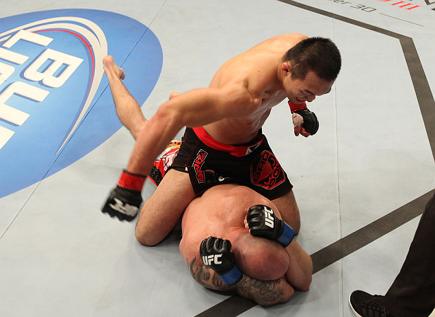 DENVER, CO - AUGUST 11:  Yushin Okami (top) punches down at Buddy Roberts during their middleweight bout at UFC 150 inside Pepsi Center on August 11, 2012 in Denver, Colorado. (Photo by Nick Laham/Zuffa LLC/Zuffa LLC via Getty Images)