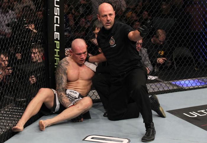 TORONTO, ON - DECEMBER 10:  (R-L) Referee Yves Lavigne calls for a doctor after Krzysztof Soszynski was knocked out by Igor Pokrajac during the UFC 140 event at Air Canada Centre on December 10, 2011 in Toronto, Ontario, Canada.  (Photo by Nick Laham/Zuff