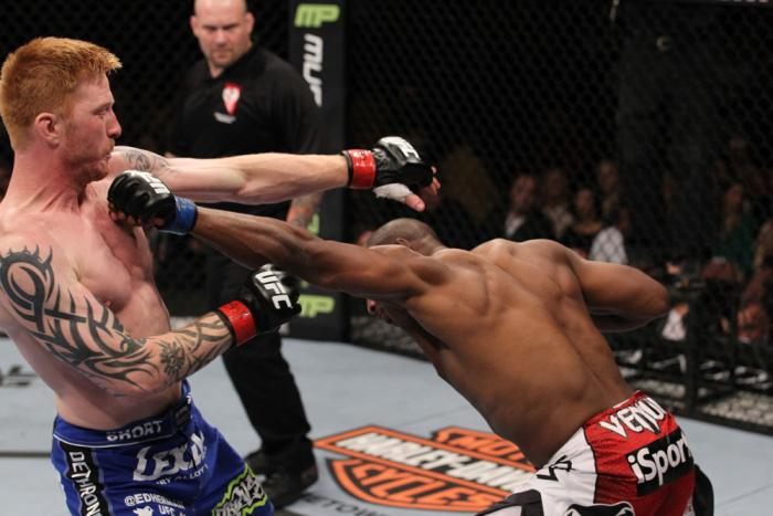 LAS VEGAS, NV - FEBRUARY 04:  Clifford Starks (right) punches Ed Herman during the UFC 143 event at Mandalay Bay Events Center on February 4, 2012 in Las Vegas, Nevada.  (Photo by Nick Laham/Zuffa LLC/Zuffa LLC via Getty Images) *** Local Caption *** Clif