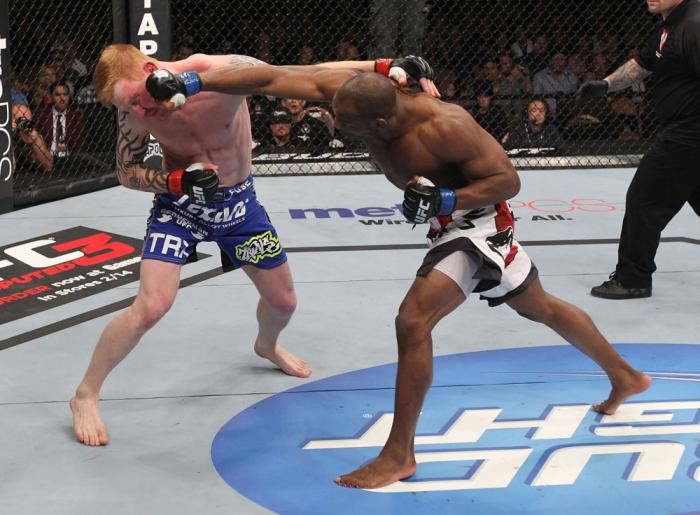 LAS VEGAS, NV - FEBRUARY 04:  (R-L) Clifford Starks punches Ed Herman during the UFC 143 event at Mandalay Bay Events Center on February 4, 2012 in Las Vegas, Nevada.  (Photo by Nick Laham/Zuffa LLC/Zuffa LLC via Getty Images) *** Local Caption *** Cliffo