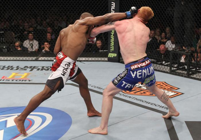 LAS VEGAS, NV - FEBRUARY 04:  Clifford Starks (left) punches Ed Herman during the UFC 143 event at Mandalay Bay Events Center on February 4, 2012 in Las Vegas, Nevada.  (Photo by Nick Laham/Zuffa LLC/Zuffa LLC via Getty Images) *** Local Caption *** Cliff
