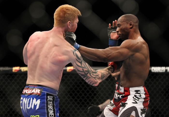 LAS VEGAS, NV - FEBRUARY 04:  Ed Herman (left) punches Clifford Starks during the UFC 143 event at Mandalay Bay Events Center on February 4, 2012 in Las Vegas, Nevada.  (Photo by Josh Hedges/Zuffa LLC/Zuffa LLC via Getty Images) *** Local Caption *** Ed H