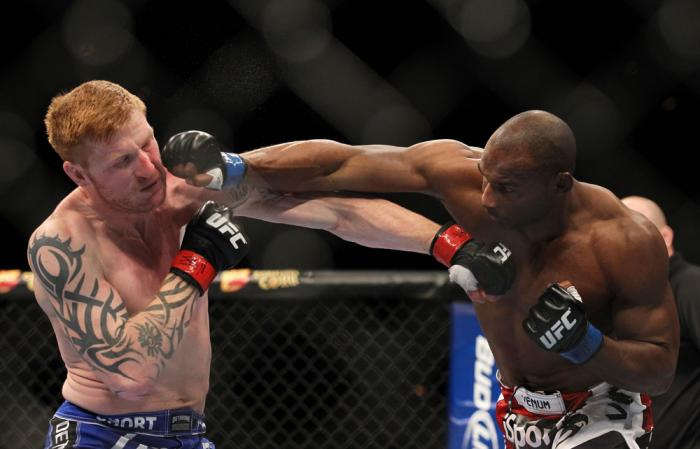 LAS VEGAS, NV - FEBRUARY 04:  (L-R) Ed Herman and Clifford Starks exchange punches during the UFC 143 event at Mandalay Bay Events Center on February 4, 2012 in Las Vegas, Nevada.  (Photo by Josh Hedges/Zuffa LLC/Zuffa LLC via Getty Images) *** Local Capt