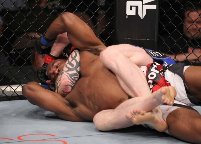 LAS VEGAS, NV - FEBRUARY 04:  Ed Herman attempts to submit Clifford Starks (red/white/black shorts) during the UFC 143 event at Mandalay Bay Events Center on February 4, 2012 in Las Vegas, Nevada.  (Photo by Nick Laham/Zuffa LLC/Zuffa LLC via Getty Images