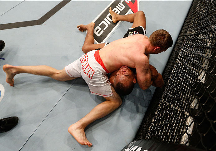 BELO HORIZONTE, BRAZIL - SEPTEMBER 04:  Piotr Hallmann (top) secures a kimura submission against Francisco Trinaldo in their lightweight fight during the UFC on FOX Sports 1 event at Mineirinho Arena on September 4, 2013 in Belo Horizonte, Brazil. (Photo