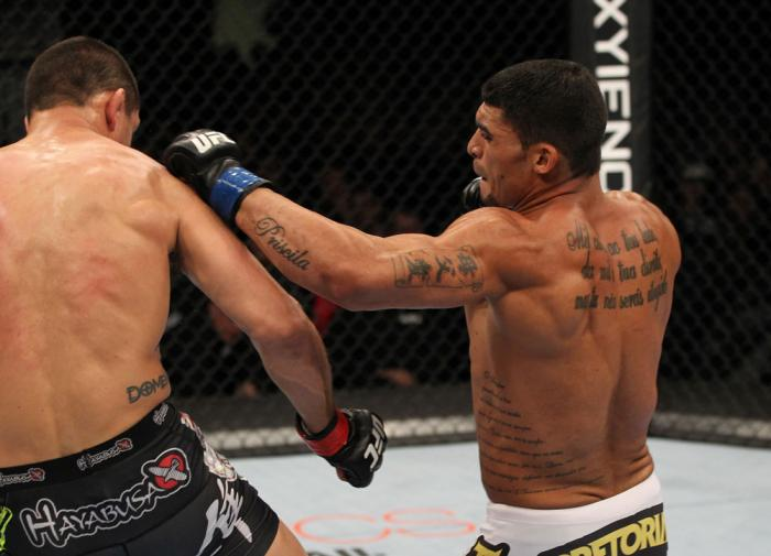 OMAHA, NE - FEBRUARY 15:  (R-L) Ronny Markes punches Aaron Simpson during the UFC on FUEL TV event at Omaha Civic Auditorium on February 15, 2012 in Omaha, Nebraska.  (Photo by Josh Hedges/Zuffa LLC/Zuffa LLC via Getty Images) *** Local Caption *** Aaron