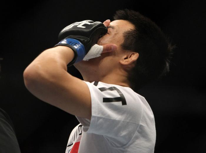 """TORONTO, ON - DECEMBER 10:  """"The Korean Zombie"""" Chan Sung Jung reacts after knocking out Mark Hominick during the UFC 140 event at Air Canada Centre on December 10, 2011 in Toronto, Ontario, Canada.  (Photo by Josh Hedges/Zuffa LLC/Zuffa LLC via Getty Ima"""
