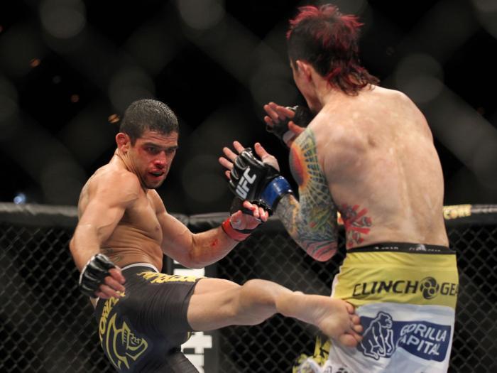 LAS VEGAS, NV - FEBRUARY 04:  Renan Barao (left) kicks Scott Jorgensen during the UFC 143 event at Mandalay Bay Events Center on February 4, 2012 in Las Vegas, Nevada.  (Photo by Josh Hedges/Zuffa LLC/Zuffa LLC via Getty Images) *** Local Caption *** Rena