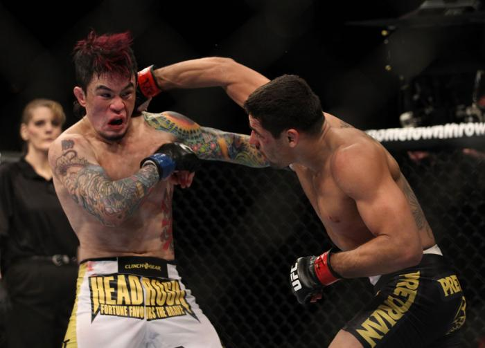 LAS VEGAS, NV - FEBRUARY 04:  Renan Barao (right) punches Scott Jorgensen during the UFC 143 event at Mandalay Bay Events Center on February 4, 2012 in Las Vegas, Nevada.  (Photo by Josh Hedges/Zuffa LLC/Zuffa LLC via Getty Images) *** Local Caption *** R