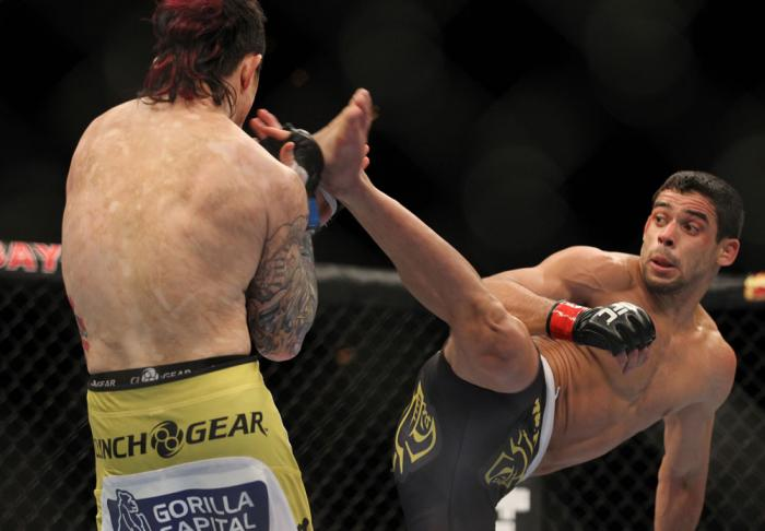 LAS VEGAS, NV - FEBRUARY 04:  Renan Barao (right) attempts to kick Scott Jorgensen during the UFC 143 event at Mandalay Bay Events Center on February 4, 2012 in Las Vegas, Nevada.  (Photo by Josh Hedges/Zuffa LLC/Zuffa LLC via Getty Images) *** Local Capt