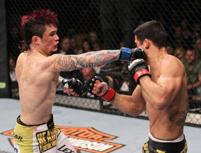 LAS VEGAS, NV - FEBRUARY 04:  Scott Jorgensen (left) punches Renan Barao during the UFC 143 event at Mandalay Bay Events Center on February 4, 2012 in Las Vegas, Nevada.  (Photo by Nick Laham/Zuffa LLC/Zuffa LLC via Getty Images) *** Local Caption *** Sco