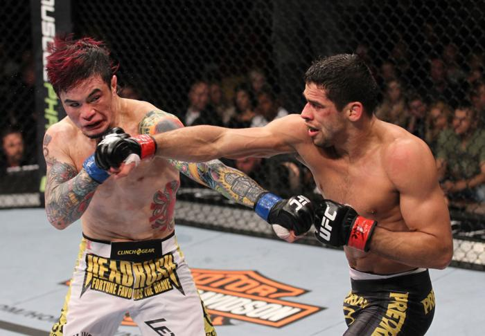 LAS VEGAS, NV - FEBRUARY 04:  Scott Jorgensen (left) and Renan Barao (right) exchange punches during the UFC 143 event at Mandalay Bay Events Center on February 4, 2012 in Las Vegas, Nevada.  (Photo by Nick Laham/Zuffa LLC/Zuffa LLC via Getty Images) ***