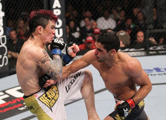LAS VEGAS, NV - FEBRUARY 04:  Renan Barao (right) punches Scott Jorgensen during the UFC 143 event at Mandalay Bay Events Center on February 4, 2012 in Las Vegas, Nevada.  (Photo by Nick Laham/Zuffa LLC/Zuffa LLC via Getty Images) *** Local Caption *** Re