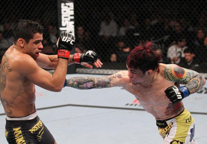 LAS VEGAS, NV - FEBRUARY 04:  Scott Jorgensen (right) punches Renan Barao during the UFC 143 event at Mandalay Bay Events Center on February 4, 2012 in Las Vegas, Nevada.  (Photo by Nick Laham/Zuffa LLC/Zuffa LLC via Getty Images) *** Local Caption *** Sc