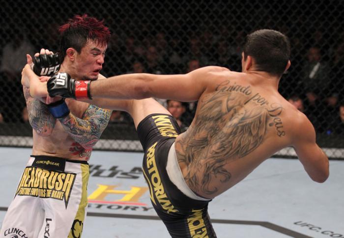 LAS VEGAS, NV - FEBRUARY 04:  Renan Barao (right) kicks Scott Jorgensen during the UFC 143 event at Mandalay Bay Events Center on February 4, 2012 in Las Vegas, Nevada.  (Photo by Nick Laham/Zuffa LLC/Zuffa LLC via Getty Images) *** Local Caption *** Rena