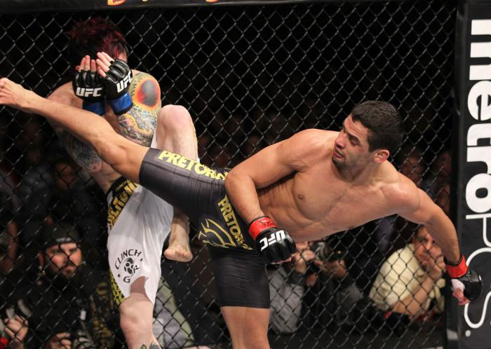 LAS VEGAS, NV - FEBRUARY 04:  Renan Barao (right) delivers a roundhouse kick to Scott Jorgensen during the UFC 143 event at Mandalay Bay Events Center on February 4, 2012 in Las Vegas, Nevada.  (Photo by Nick Laham/Zuffa LLC/Zuffa LLC via Getty Images) **