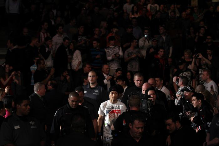 """TORONTO, ON - DECEMBER 10:  """"The Korean Zombie"""" Chan Sung Jung enters the arena before his bout against Mark Hominick during the UFC 140 event at Air Canada Centre on December 10, 2011 in Toronto, Ontario, Canada.  (Photo by Nick Laham/Zuffa LLC/Zuffa LLC"""