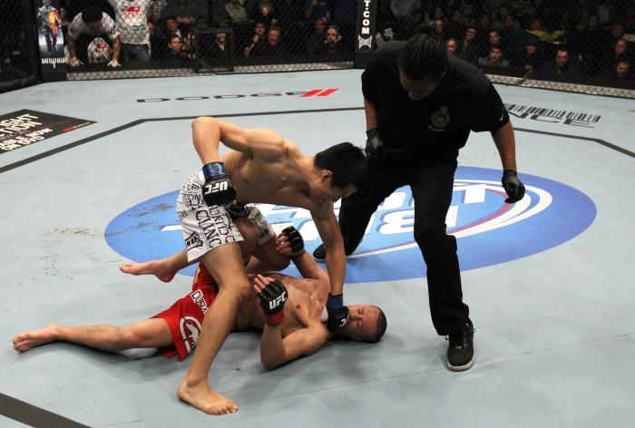 """TORONTO, ON - DECEMBER 10: (L-R) """"The Korean Zombie"""" Chan Sung Jung defeats Mark Hominick by knockout during the UFC 140 event at Air Canada Centre on December 10, 2011 in Toronto, Ontario, Canada. (Photo by Nick Laham/Zuffa LLC/Zuffa LLC via Getty Images"""