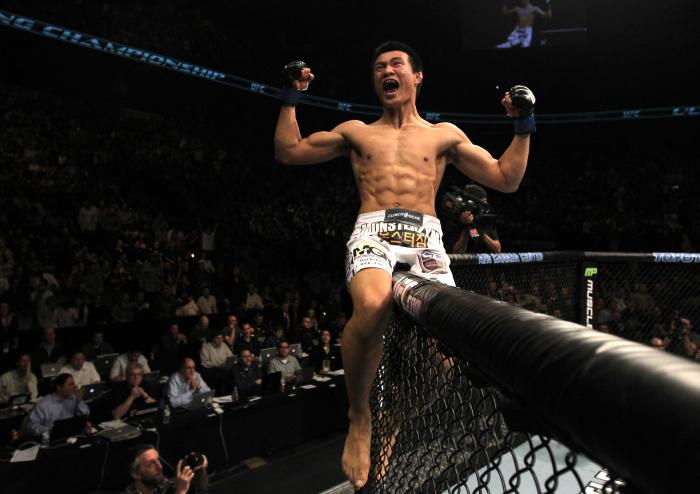 """TORONTO, ON - DECEMBER 10:  """"The Korean Zombie"""" Chan Sung Jung reacts after knocking out Mark Hominick during the UFC 140 event at Air Canada Centre on December 10, 2011 in Toronto, Ontario, Canada.  (Photo by Nick Laham/Zuffa LLC/Zuffa LLC via Getty Imag"""